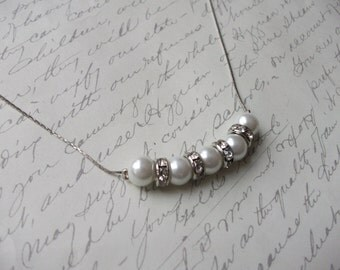 Glass pearl necklace on fine chain