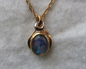 "Opal Pendant Beautiful flashes of color, set in gold setting with 18"" chain"