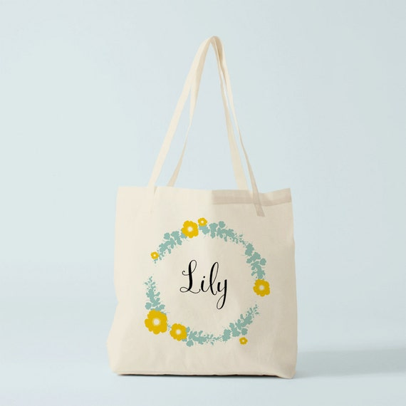 The name you want on this bag with a flowers wreath in blue and yellow tones, personnalized tote bag, canvas bag, custom gift, novelty.