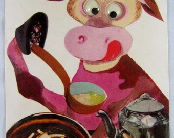 Vintage 60's moving-eyes postcard ~ a cow cooking in the kitchen ~ made in ISRAEL