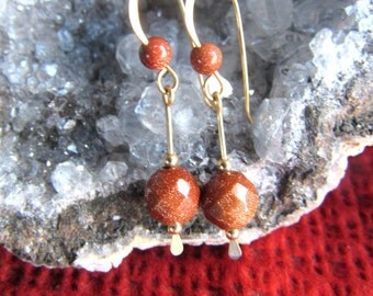 Earrings faceted goldstone  on 12k goldfilled, or sterling silver, handmade french earwires, length 1 3/8 inch, alot of sparkle in goldstone