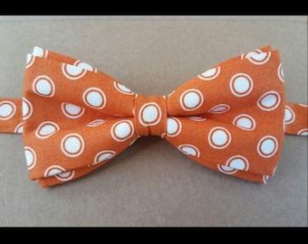 Orange and white polka dot bow tie