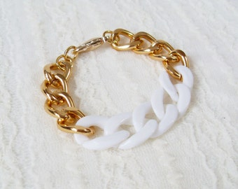 White and Gold Chain Bracelet. A Chunky Gold Chain Bracelet with White Acrylic Chain. Simple and Chic.