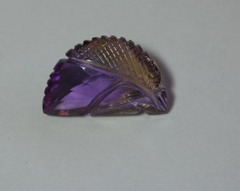 17 carat carved ametrine gem