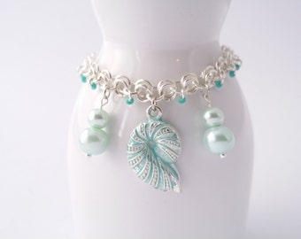 Turquoise seashell and pearl charm bracelet, adorned with delicate matching seed beads