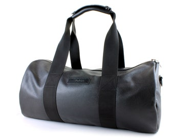 Leather duffel bag made from soft black leather, Leather duffle with wateproof lining & detachable shoulder strap