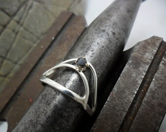 Sterling silver ring set with a black diamond