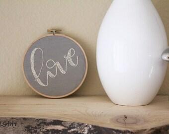 embroidery hoop: love