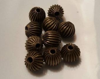 Beautiful Bronze Beads with Etching 55 pcs