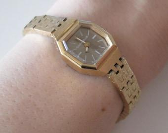 Caravelle Swiss vintage gold tone Hand wind Women's Watch