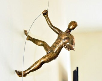 Man Climbing Sculpture Wall Art