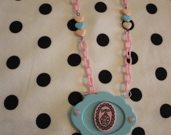 Blue cupcake came necklace