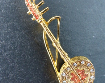 Vintage 1980s - Gold-tone Bollywood-style Indian/Asian Musical Instrument Brooch