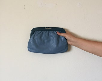 blue genuine leather clutch