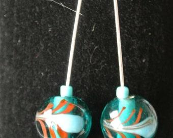 Teal patterned glass bead earrings