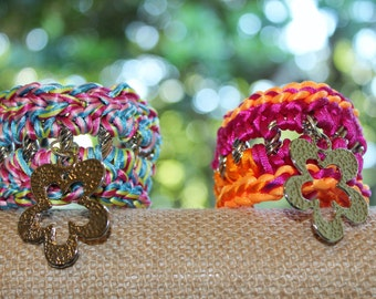 Colorful crochet bracelet with flower charm.