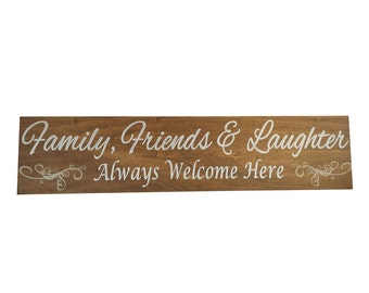 Family Friends and Laughter always welcome here sign
