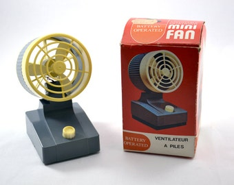 Vintage mini fan with adjustable swirl wind / original cardboard box 70s