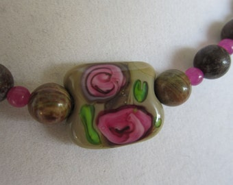 Lamp work glass bead necklace in brown and rose