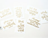 custom gold handwritten wedding table signs with love quotes // handwriting in silver calligraphy font for wedding decor