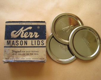 Vintage set of 4 Kerr Mason Jar Lids in box