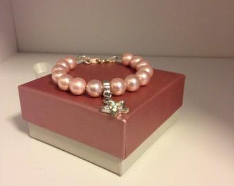 Pink shell pearl girls charm bracelet.