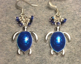 Dark blue enamel turtle charm earrings adorned with tiny dark blue Chinese crystal beads.
