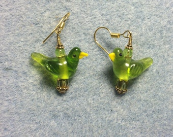Olive green lampwork songbird bead dangle earrings adorned with olive green Czech glass beads.