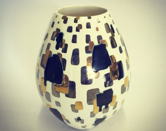 Ceramic pot with glaze and gold lustre.