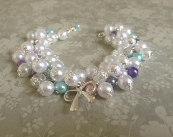 Cute bracelet from beads with ribbon