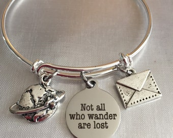 """Travel adjustable bangle bracelet with world envelope and """"not all who wonder are lost"""" charm"""