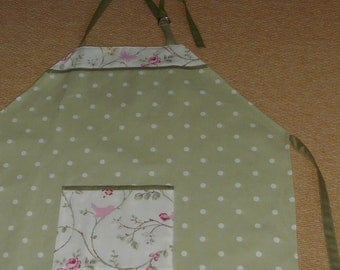 Green and white dotted apron