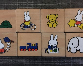 8 wooden blocks with illustrations made by Dick Bruna (nijntje/miffy)