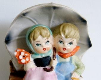 Vintage HUMMEL like style Music Box boy and girl under umbrella made by Artmark Original