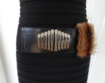Black belt trimmed with fur!