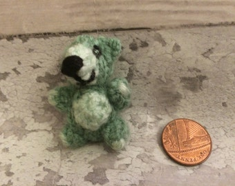 Cute green mini knitted bear creature