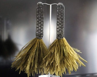 Earring made of yellow feathers and black strass