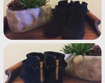 Vintage black suede Minnetonka moccasins.