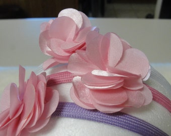 Three headband in purple, pink and gray, each with a pink flower. Handmade.