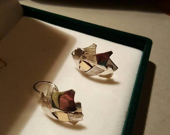 Unique and precious silver and 18 k gold earrings