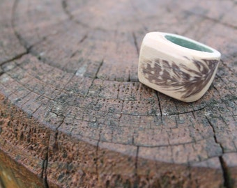 Feather on Raw wood statement ring.