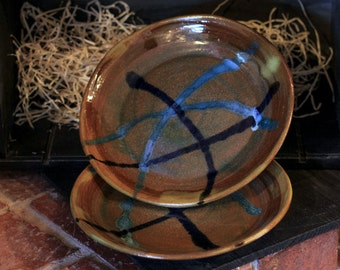 8 inch wheel thrown plates with a brown and blue glazes