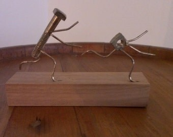 The Screw Chases the Nut ~~~~~ Funny  Sculpture