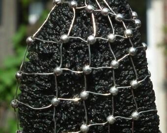 Moldavite in silver wire