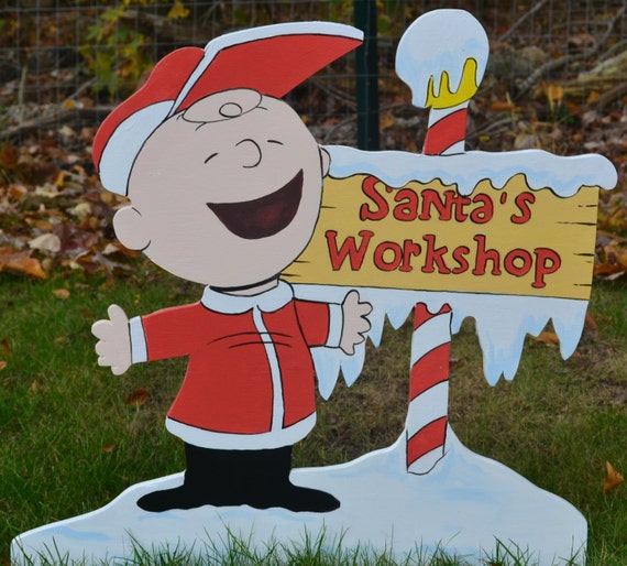 Charlie Brown has found Santa's Workshop lawn stake or wall plaque