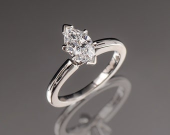 "Platinum ""Derco"" Diamond solitaire ring"