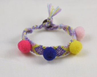 Boho Friendship Braid Woven Bracelet pompons on it