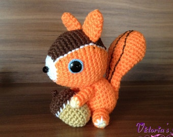 Crochet-knitted amigurumi 'Squirrel with an acorn'