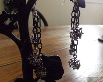 Web dangle earrings