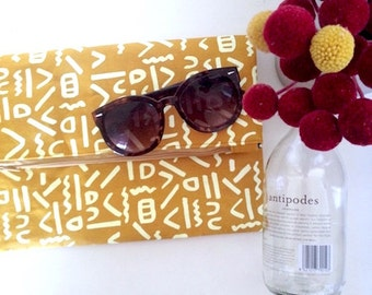 mustard and white squiggle washable paper clutch